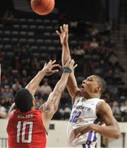 ACU's Joe Pleasant (32) shoots over Southeast Missouri State's Quatarrius Wilson (10) in the second half. ACU beat the Redhawks 73-64 in a nonconference game Thursday at Moody Coliseum.