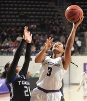 ACU's Dominique Golightly (3) shoots over Tulsa's Rebecca Lescay (21) during the second half. ACU beat the Golden Hurricane 73-63 in a nonconference game Thursday at Moody Coliseum.