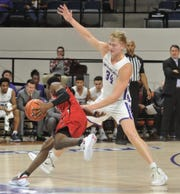 """ACU""""s Kolton Kohl (34) defends against a Southeast Missouri State player in the first half."""