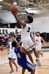 Abilene High's Jalen McGee (3) goes around a Del Rio defender for a layup during the first round of the Raising Cane's Abilene Key City Classic boys basketball tournament. The Eagles have taken control of their destiny, starting 5-0 in District 3-6A with defending champion Euless Trinity coming to Eagle Gym on Tuesday.