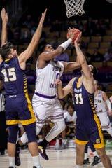 Western Carolina forward Carlos Dotson goes strong to the basket.