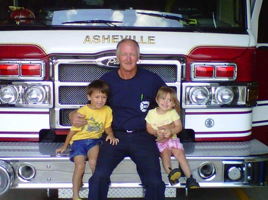 Frank Morris, seen here with two of his five grandchildren, was an Asheville Firefighter for 25 years. He died Nov. 29 of cancer.
