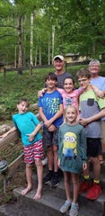 Frank Morris and his wife, Bonnie, are seen here in a recent photo with his five grandchildren. Morris, a retired Asheville firefighter, died Nov. 29 of cancer.