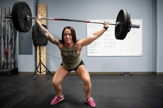 Michelle Tidwell lefts weights at Battle Creek CrossFit on Friday, Dec. 6, 2019 in Battle Creek, Mich. Battle Creek CrossFit recently moved locations from Columbia Ave. to downtown on Michigan Ave.