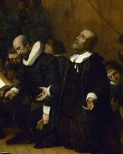 The Rev. John Robinson is seen praying with the Pilgrims as they board the Mayflower, from the painting on the ceiling of the Capitol Rotunda.