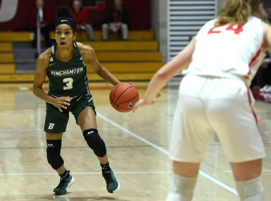 Binghamton University's Kai Moon looks for an opening past Laura Bagwell-Katalinich during Binghamton University's 59-56 victory Thursday night in Ithaca.