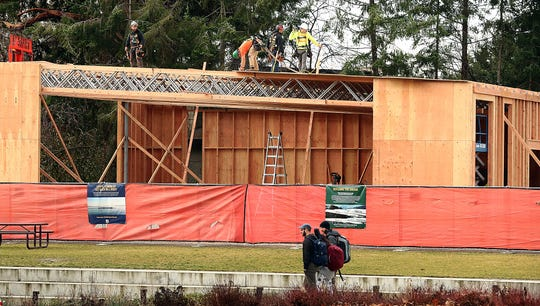 Construction crews work on the next phase of the Bainbridge Island Rowing Center in Waterfront Park on Friday, December 6, 2019.