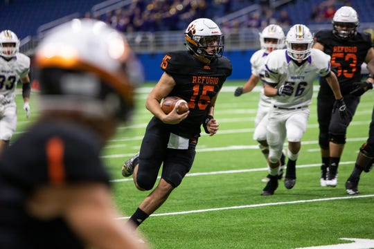 Refugio's Austin Ochoa runs down field during the Class 2A, Division I quarterfinal against Holland on Thursday night at the Alamodome in San Antonio.