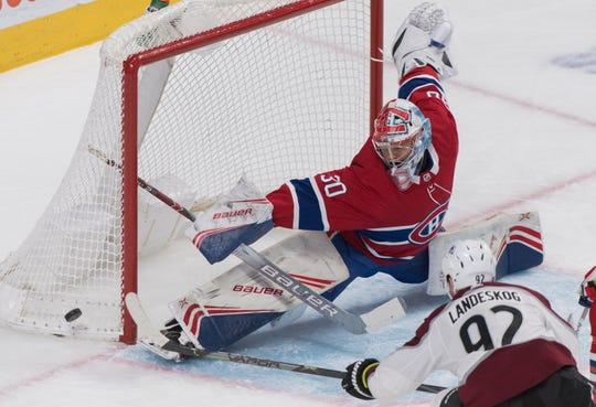 Montreal Canadiens goaltender Cayden Primeau makes a save against Colorado Avalanche's Gabriel Landeskog. He finished with 32 stops.