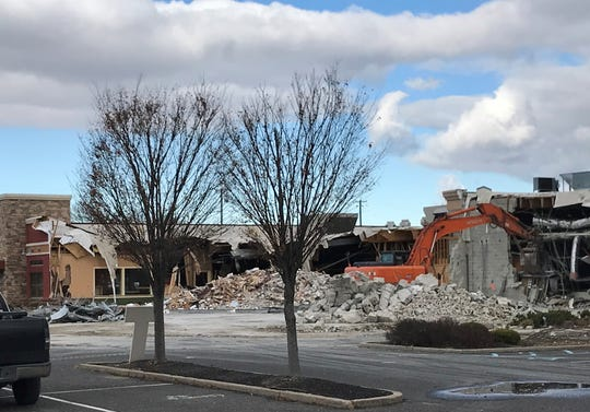 A demolition crew is taking down the former Chili's and Blue2o restaurants at Route 70 and Haddonfield Road in Cherry Hill.