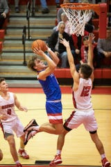 Zane Trace guard Colby Swain goes up for a layup during a 56-47 win over Logan Elm at Logan Elm High School in Circleville, Ohio, on Thursday, Dec. 5, 2019. Zane Trace is a team to be reckoned with in Southern Ohio and point guard Colby Swain's point guard abilities make them the elite team they are.