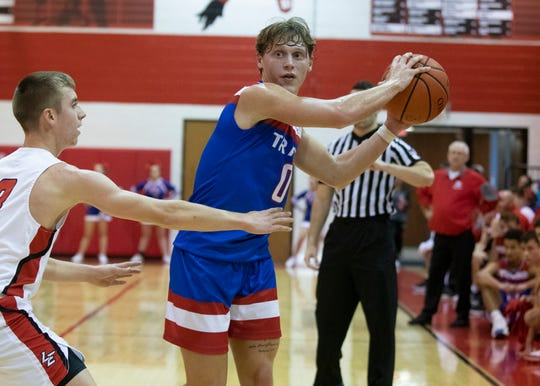 Zane Trace guard Colby Swain looks to pass during a 56-47 win over Logan Elm at Logan Elm High School in Circleville, Ohio, on Thursday, Dec. 5, 2019. Zane Trace is a team to be reckoned with in Southern Ohio and point guard Colby Swain's point guard abilities make them the elite team they are.