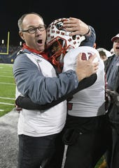 La Salle head coach Pat McLaughlin celebrates in the closing moments of the Lancers win in the OHSAA Division II state final game at Tom Benson Hall of Fame Stadium in Canton, Dec. 5, 2019.