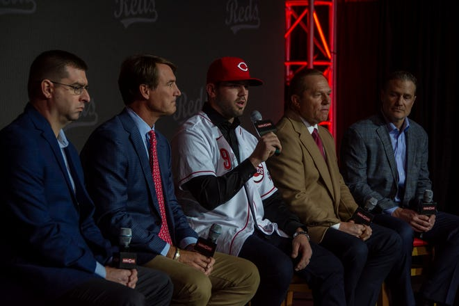 Cincinnati Reds infielder Mike Moustakas, center, addresses the media at his introductory press conference on Dec. 5, 2019 at the Duke Energy Convention Center. From left, Reds general manager Nick Krall, president of baseball operations Dick Williams, Moustakas, agent Scott Boras, and manager David Bell