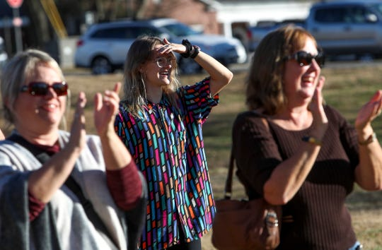 Crowd members clap and cheer for Bryan Gaither after a successful launch of a flaming pumpkin at Winnfield Dunn Center in Clarksville, Tenn., on Thursday, Dec. 5, 2019.