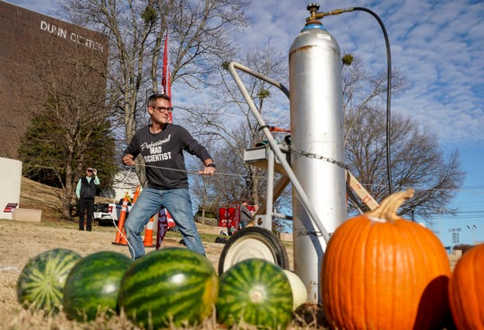 Bryan Gaither pulls the release on a trebuchet he created over the course of two years and built in a week to throw pumpkins on what happens to be his birthday at Winnfield Dunn Center in Clarksville, Tenn., on Thursday, Dec. 5, 2019.