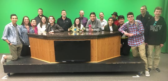 Five of the six NovemBeard contestants with students members of BRTV. Pictured are staff contestants (back row): Dan Kavanagh, Dave Altemose, Dave Evans, Scott Strungis and Steve Rubin BRTV students (front row): Brandon Narvaezzi, Elisa Tarbell, Nina Pardo, Breanna Reynolds, Jacob Nice, Hannah Grynberg, Johan Zuniga, Sanya Bhatia, Dan Amorim, Joe Lauria, DJ Berchoff and Jack Smith, Missing from the photo is NovemBeard contestant Tom Bourgault.