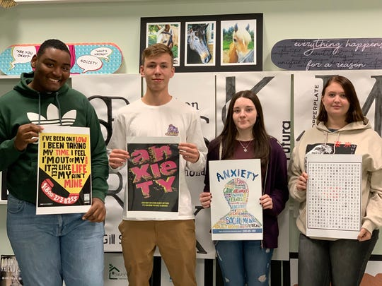 Pictured from (left to right) are Graphic Design students Domontaa Thomas, Garrett Loescher, Saige Brelsford, and Myia Smith. Their posters were selected as winners in Cabrini University's Art + Effect High School Poster Contest, which had a theme this year of mental health.