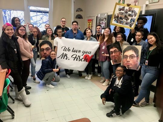 Linden High School teacher Anthony Fischetti, center, surrounded by students after learning he was chosen as an Exemplary Teacher by the New Jersey Department of Education.