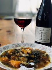 Juniper Hill dish of Two Barn Farm squash soup with Annandale Village dried shiitake mushrooms, Two Barn Farm kale and Castle Valley Mill farro alongside Terres Vivantes Beaujolais-Villages La Lutine 2018, a biodynamic wine.