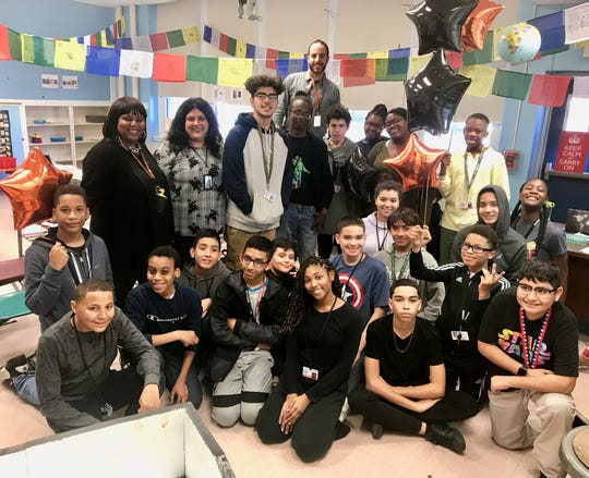 Peter Citera, top center, teacher at Soehl Middle School in Linden, surrounded by students and school administrators after learning he was chosen as an Exemplary Teacher by the New Jersey Department of Education.