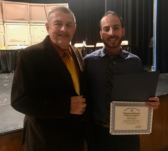 Peter Citera, right, teacher at Soehl Middle School in Linden, with Board of Education President Gregory R. Martucci after he was honored at the board's Tuesday, Nov. 26, meeting for being chosen as an Exemplary Teacher by the New Jersey Department of Education.