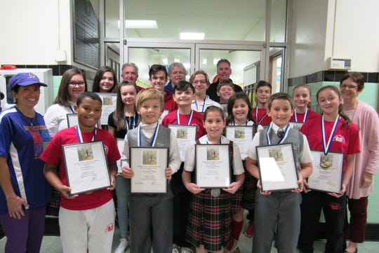 Congratulations to the St. Francis Cathedral School (SFCS) students that were awarded  medals and certificates at the Metuchen Elks 1914 Soccer Shoot Out. Pictured in the front row (left to right) are: Eli Waterman, Ben Oakes, DeAnna Freeman, Kevin Kelly and Fiorella Perone.  In the middle row (left to right) are: Carolyn Roberts, physical education teacherl Sandra Abrantes,  Aoife Scott, Alex Arrevillagas, Quinn Kenney, Paige Logan and Ann Major, principal. In the back row (left to right) are: Sophia Sorge,  Nick Doroschenko, Metuchen Elks Lodge 1914; Peter Meier, Mike Walsh, Metuchen Elks Lodge 1914; Alex Patelski, Riley Hornby, Lucas Teboul Pabon and John Gaven, Metuchen Elks Lodge 1914. SFCS is located in Metuchen and educates children from Pre-K3 to eighth grade.