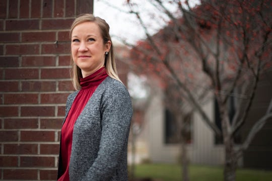 Amber Lynch, executive director of Invest DSM, and a former city planner, works within four target Des Moines neighborhoods to improve housing conditions and attract businesses.
