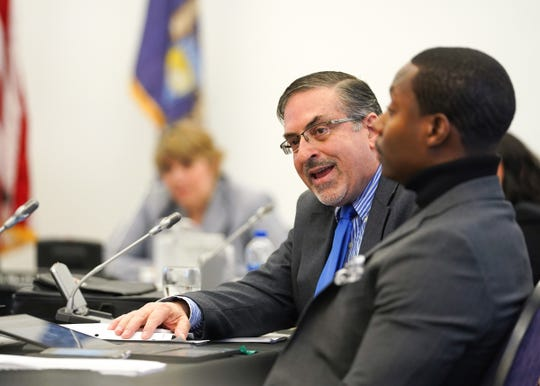 Wayne State University Board of Governors member Michael Busuito speaks in opposition of Wayne State University President M. Roy Wilson during a public meeting Dec. 6.