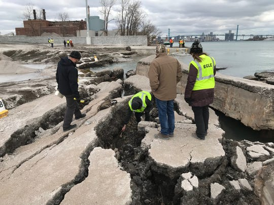 The Michigan Department of Environment, Great Lakes and Energy(EGLE) survey a Detroit property contaminated with uranium and other dangerous chemicals that partially collapsed into the Detroit River on Friday, December 6, 2019.