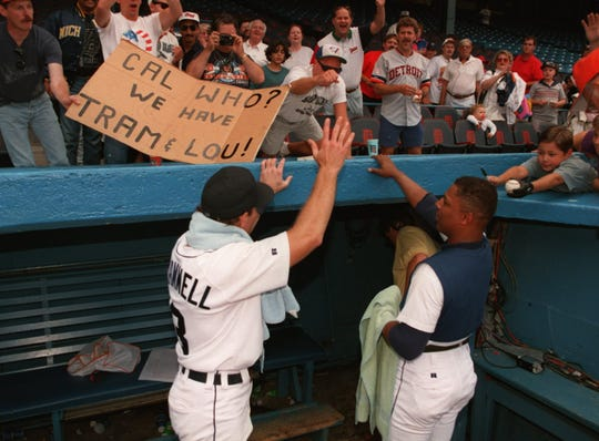 Detroit Tigers' Alan Trammell, left, and Lou Whitaker talk to fans after the Tigers beat the visiting Brewers.