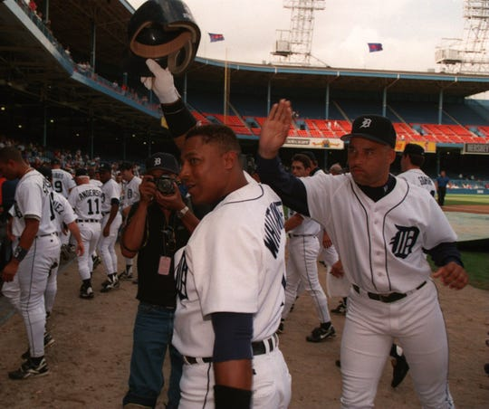 Detroit Tigers' 2nd baseman (1) Lou Whitaker tips his hat to the crowd as he gets a pat on the back from Jose Lima. Whitaker knocked in the winning runs with a bottom of the 9th home run to beat the visiting Brewers.