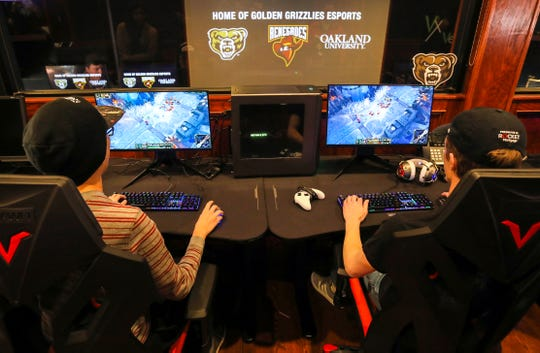 (L to R) Oakland University students and esport players Jonathan Chan, 19 of Troy and Jonathon Klotz, 20 from Clinton Township play League of Legends after the press conference on December 6, 2019 at Game Time in Auburn Hills to announce the addition of a varsity esports team. The addition of the sport makes the university the first Division 1 school in Michigan to have such a team.