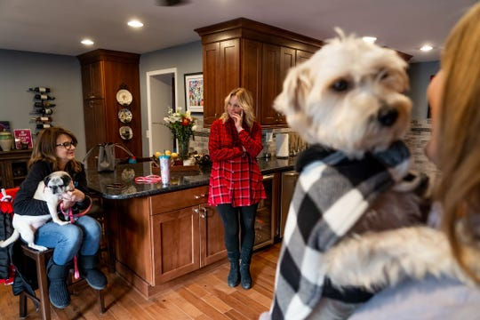 Cynthia Tewes (center) of Midwest Small Breed Rescue talks about home-based rescue groups and fosters while in the kitchen of her home in Grosse Pointe Park on Thursday, December 5, 2019 with volunteers Debi Ruggeri (left) of Grosse Pointe and Barbara Leising of Grosse Pointe Park.