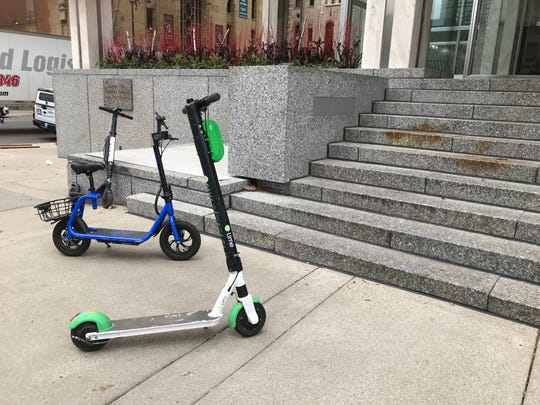 Scooters left near an entrance to the Chase Tower in downtown Detroit on Dec. 6, 2019.