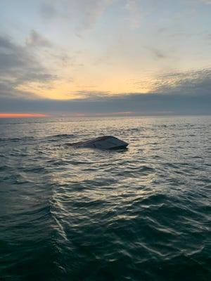 U.S. Coast Guard rescues Saginaw Bay boaters after boat capsizes.
