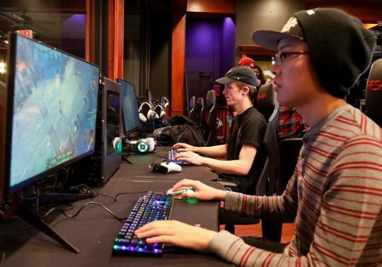Oakland University students and esport players (L to R) Jonathon Klotz, 20 from Clinton Township and Jonathan Chan, 19 of Troy play League of Legends after the press conference on December 6, 2019 at Game Time in Auburn Hills to announce the addition of a varsity esports team. The addition of the sport makes the university the first Division 1 school in Michigan to have such a team.