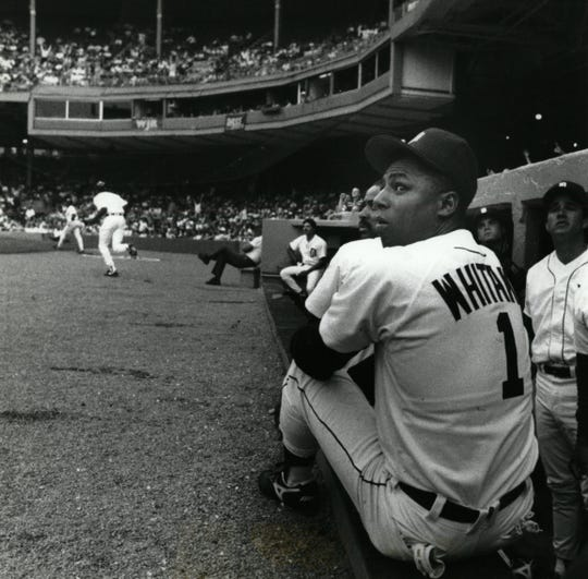 Tigers' second baseman Lou Whitaker watches from the Tigers' dugout as the first of Rob Deers home runs goes over the fence in the left field against the Minn. Twins.