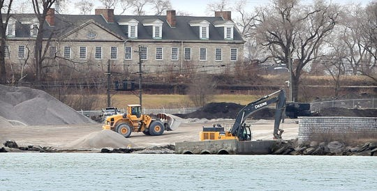Heavy machinery is seen working near the Detroit River at Detroit Bulk Storage on Wednesday, December 5, 2019. Historic Fort Wayne is seen behind.