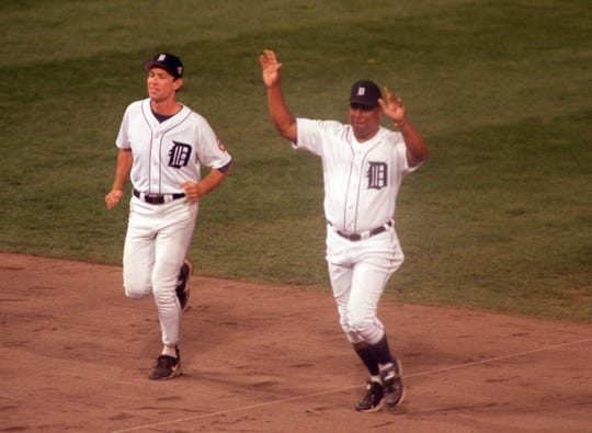 Alan Trammell (left) and Lou Whitaker (right) take the field during post-game ceremony after the Tigers and Kansas City Royals played the final game at Tiger Stadium in Detroit Monday, Sept. 27, 1999. The Tigers beat the Royals 8-2. ( Gabriel B. Tait/Detroit Free Press)   MIDTF