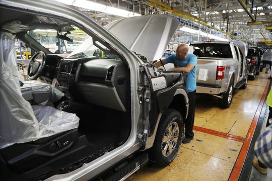 In this Sept. 27, 2018, file photo a United Auto Workers assemblyman works on a 2018 Ford F-150 truck being assembled at the Ford Rouge assembly plant in Dearborn, Mich. (AP Photo/Carlos Osorio)