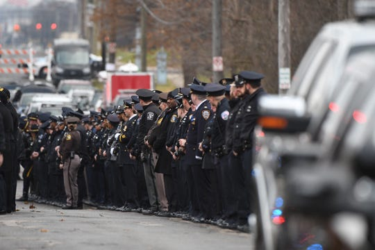Police officers line up to pay respects to fallen Detroit officer Rasheen McClain before his funeral Friday, Dec. 6, 2019.