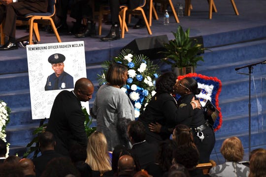 Detroit Councilwoman Brenda Jones hugs a Detroit police officer during the funeral at Greater Grace Temple in Detroit on Friday.