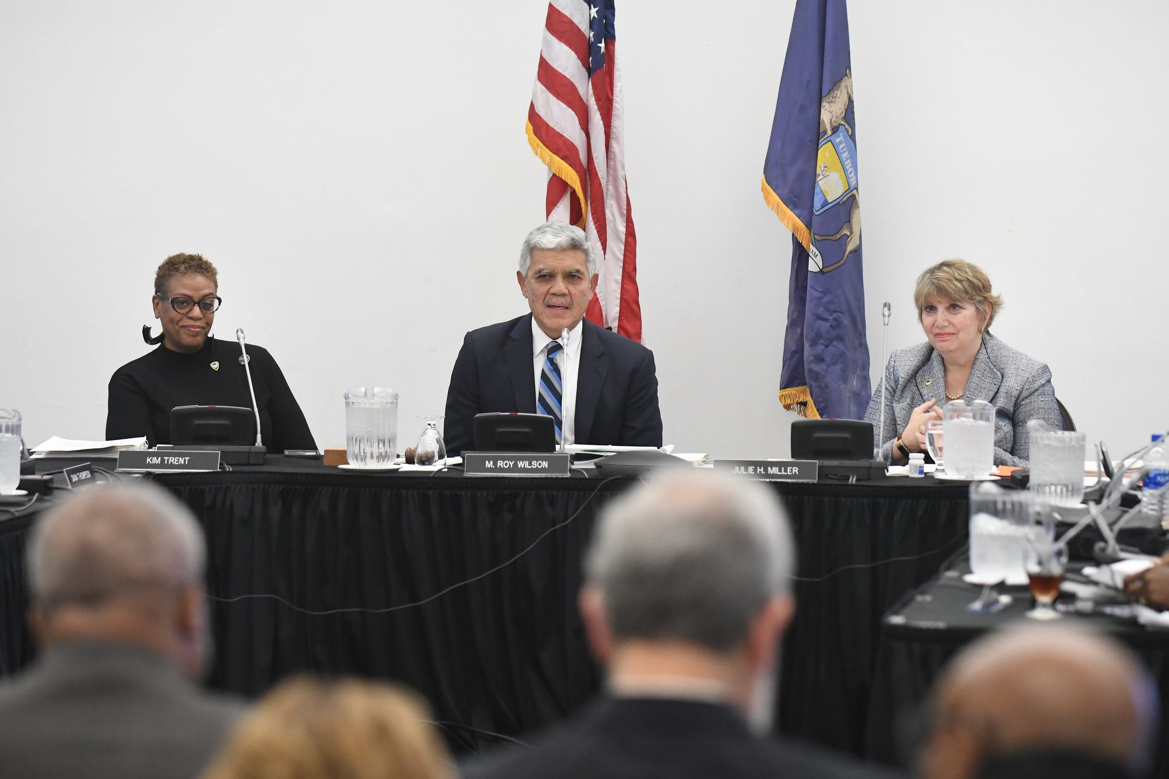 Wayne State University President Dr. M. Roy Wilson, center, speaks during a Board of Governors meeting with chair Kim Trent, left, and Secretary to the Board of Governors Julie Miller looking on.