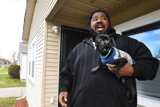 Terrence Floyd, with his pet Chihuahua, said his east-side neighborhood has been terrorized for months by a Rottweiler and pit bull.