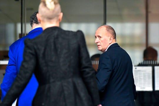 Plaintiff, British cave expert Vernon Unsworth, right, arrives at U.S. District Court Wednesday, Dec. 4, 2019, in Los Angeles.
