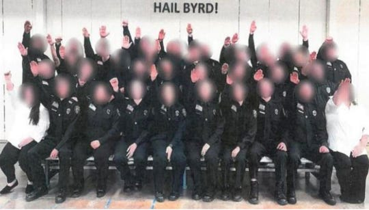 A photo surfaced in early December of a West Virginia corrections officer trainee class giving what appears to be the Nazi salute. More than 30 trainees seen in the photo were being fired, along with their instructor.