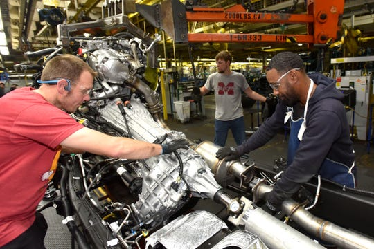 Trevor Groombridge, from left, Theron Wiley and Anthony Polite work at GM's Flint Assembly plant, where mandatory overtime has been invoked through Dec. 21. That plant already was running three shifts, six days a week.