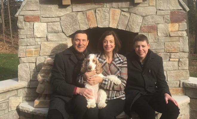 The Angeli family of Farmington Hills – from left, Larry (holding the family dog, Lucy), Alice and Anthony – were among the first purchasers of a MiABLE disability savings account. Their aim is to help secure Anthony's financial  future.
