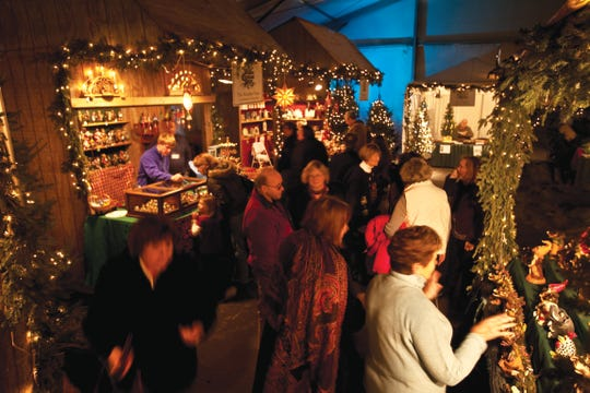 Shoppers browse booths at the Old World Christmas Market.